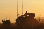 At sunset a convoy of Canadian Light Armored Vehicles over-watches the area near Khadan Village, Afghanistan, Jan. 25.